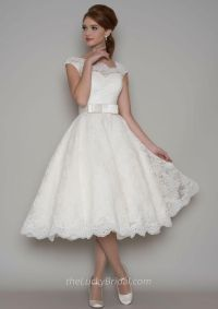 This vintage tea length a-line wedding dress features ...