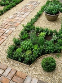 herb garden contained by pretty gravel and brick border