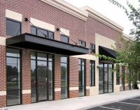 Store front-metal awning with windows above | awnings ...