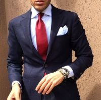 Navy suit, white shirt, bright red tie, white pocket