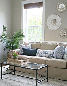 Sarah of thrifty decor chick used this comfortable beige sofa as the anchor her quickie living room makeover also cheap decorating ideas pinterest rh za