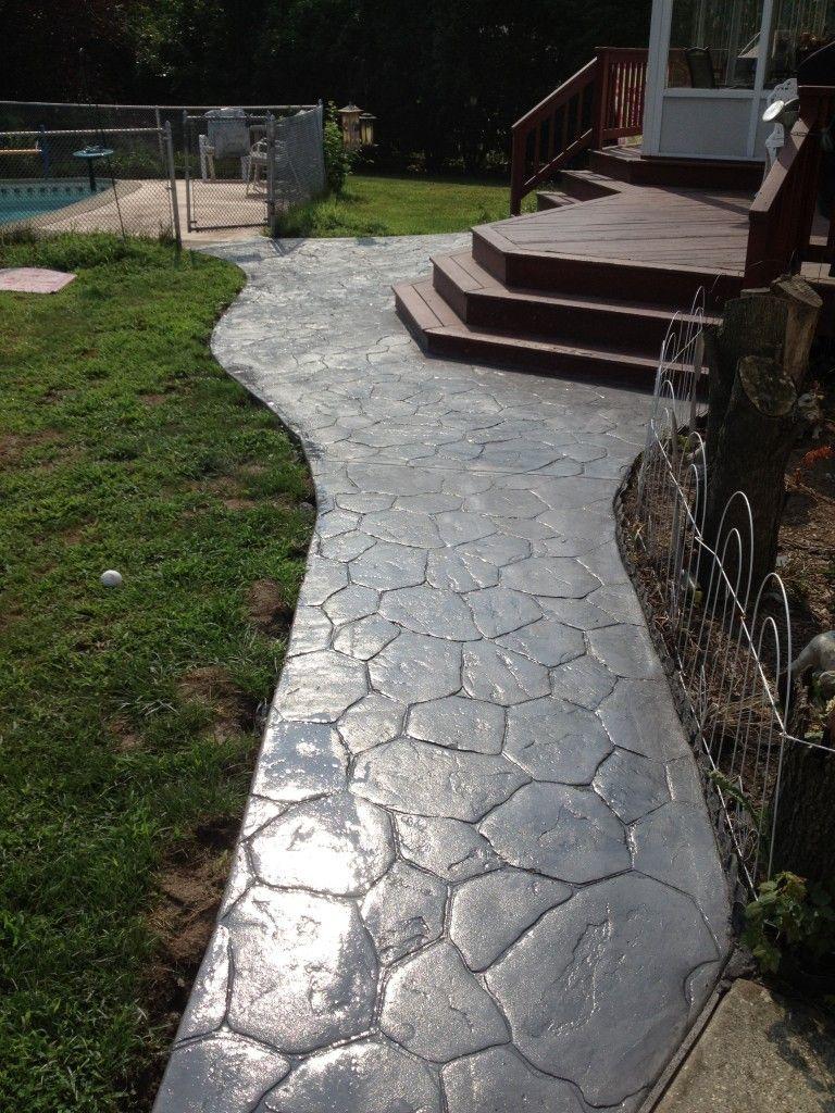 meandering paver walkway. concrete sidewalk stamped cobble
