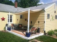 DIY shade canopy. Using planters, fence posts, buckets