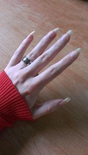 naturally long fingernails. bare