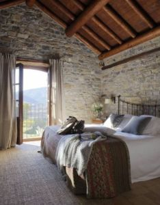 Wood ceiling and rock walls home design  like the rustic feel of room but it seems dark think more windows would need to be added also la casa de san martin es un pequeno hotel rural tan solo rh pinterest