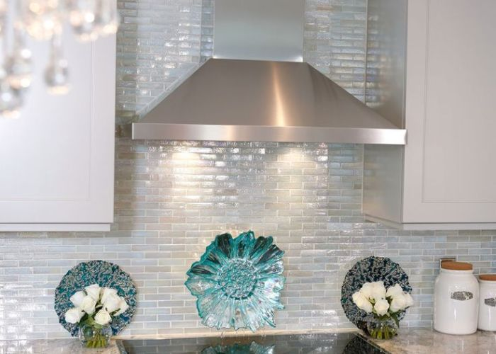 Love this iridescent tile and how it goes up to the ceiling simple stainless hood glass by lunada bay with taupe also