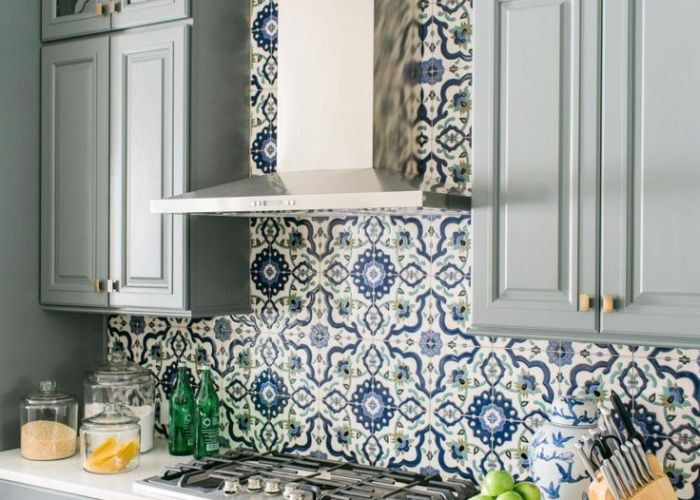 Blue and grey kitchen backsplash in moroccan patterns combined with cabinets white counter tops also