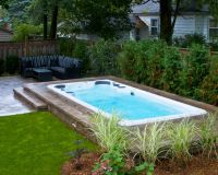 Hydropool Self Cleaning swim spa installed in ground with ...