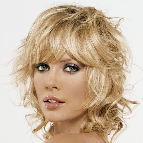 Heavily Layered Blonde Hair With Curly Spikes And Long Side Swept