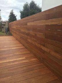 Horizontal Wood Fence. Yellow Balau Deck Boards. Finished