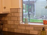 showing off the tile around window and top of wall tiles ...