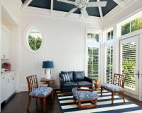 Coastal living room with white and blue striped rug ...