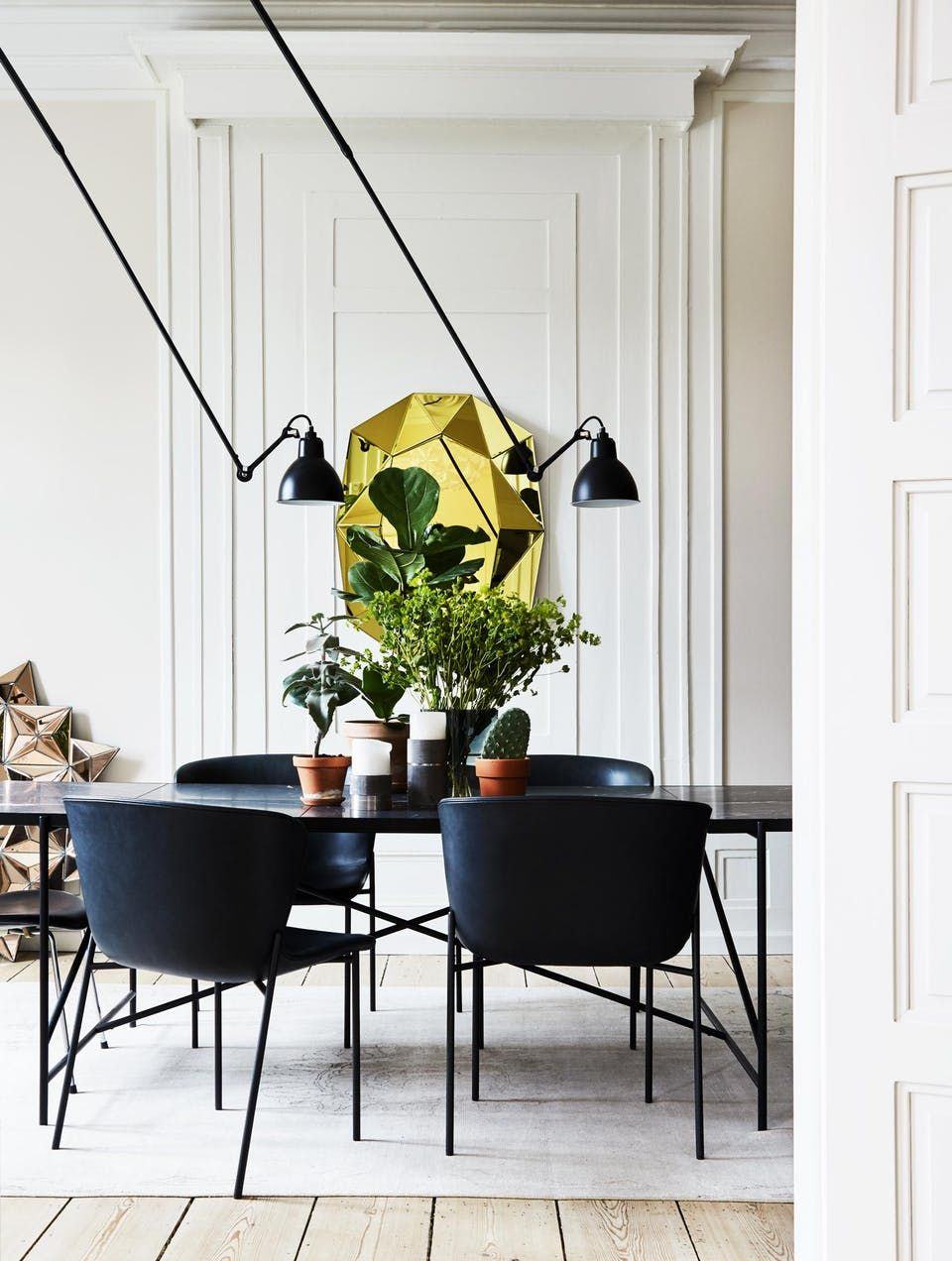 Dining room with statement elements cool sculptural lamps and gold mirror on the wall also rh pinterest
