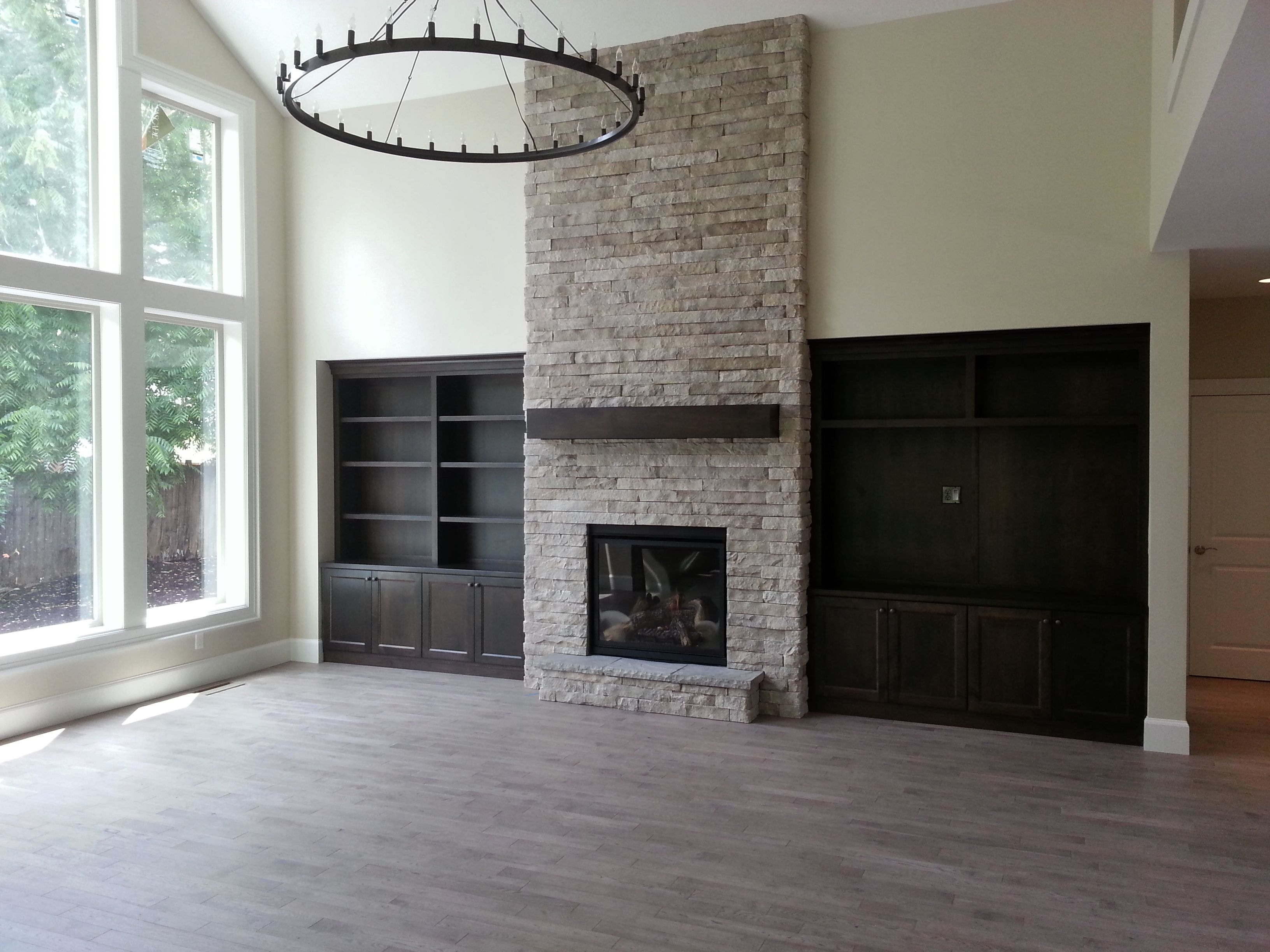 fireplace, indoor fireplace, stone to ceiling, gas