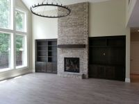 fireplace, indoor fireplace, stone to ceiling, gas ...