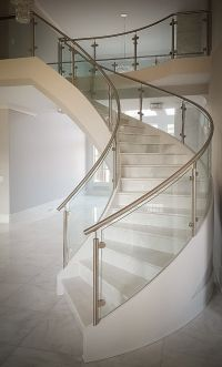 Modern curved staircase with stainless steel and glass ...