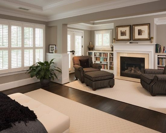 light trim and wainscoting with rich darker tones in furniture and