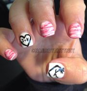 pink camo nails with browning deer