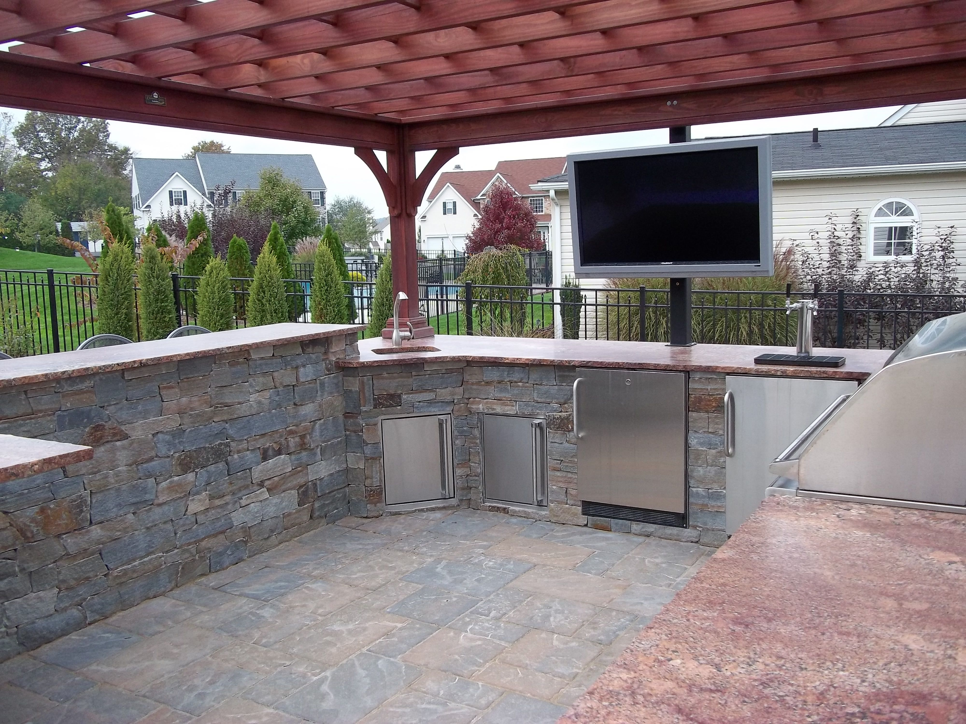 outdoor kitchen griddle storage ideas for small spaces grill fridge beer tap and tv
