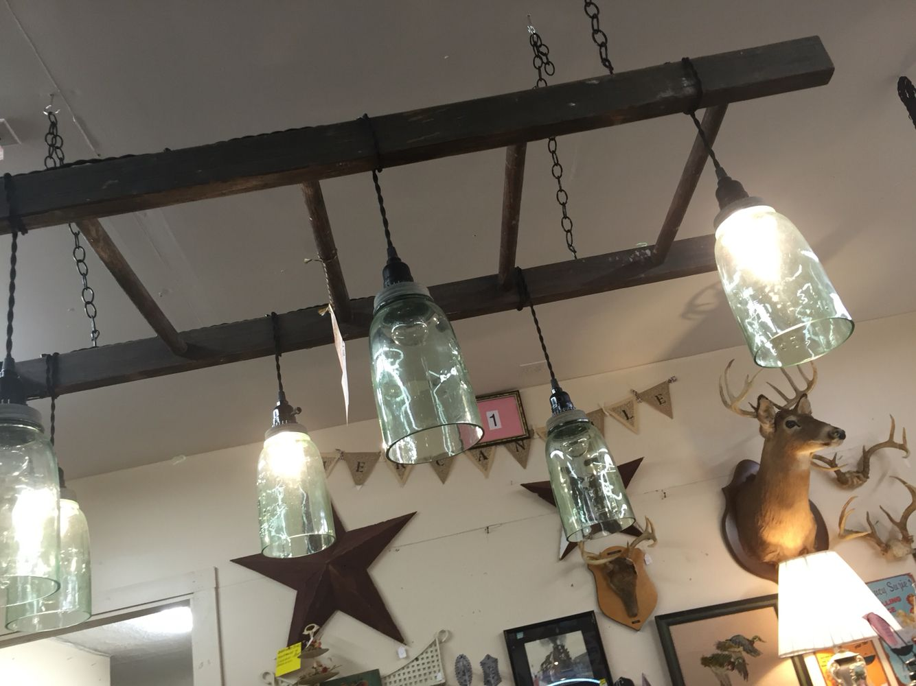 Ladder light fixture with ball jars.