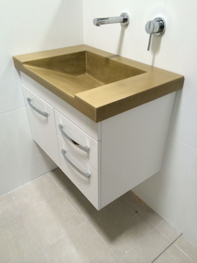 poured concrete vanity top with built in sink
