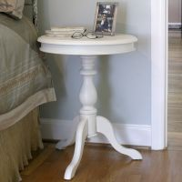 With its elegant pedestal and vibrant ivory finish, this ...