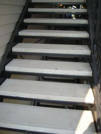 iron-anvil-stairs-double-stringer-treads-concrete-smooth ...