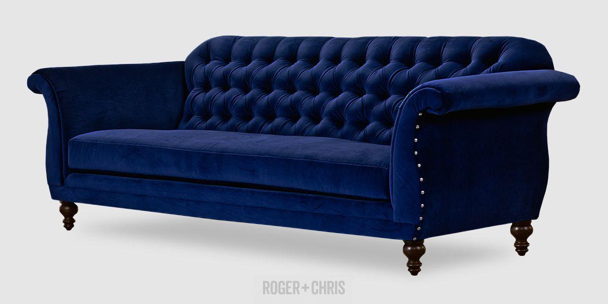 Tufted lapis blue velvet scroll arm sofa