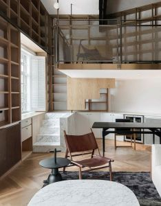 Atelier tao  has renovated  top floor apartment in one of the earliest also study takes centre stage bookshelf lined rh za pinterest