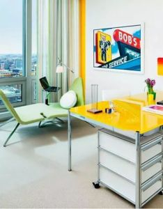 In this bright and modern office interior designer michael richman paired  cheery yellow desk with herman miller   eames management chair also werk play pinterest rh