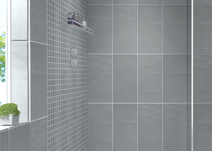 Create  modern looking bathroom by mixing different shapes of floor tiles walls  also in