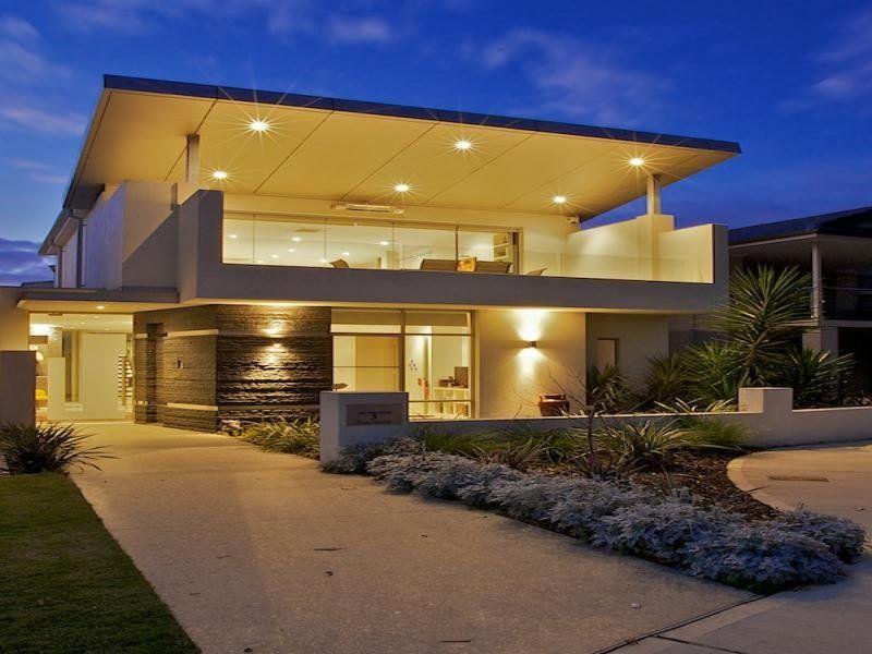 Concrete Modern House Exterior With Balcony & Decorative Lighting
