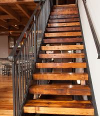 Stairs to loft: wrought iron railing, repurposed beams ...