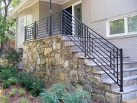 Outdoor Stone Steps and Iron Railing | HGTV | Front steps ...