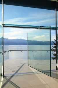 Solid glass door on a pivot hinge. Way cool, but damn that ...