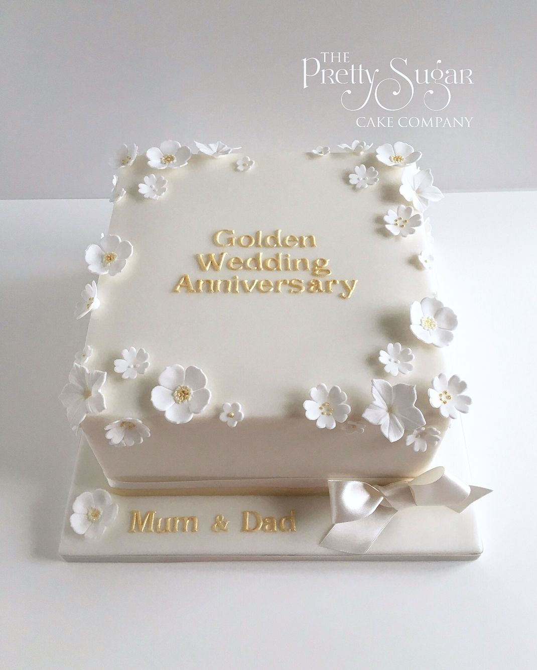 Golden Wedding Anniversary Cake With White And Gold