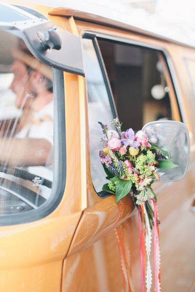 For a wedding car with a cool beach vibe decorate a