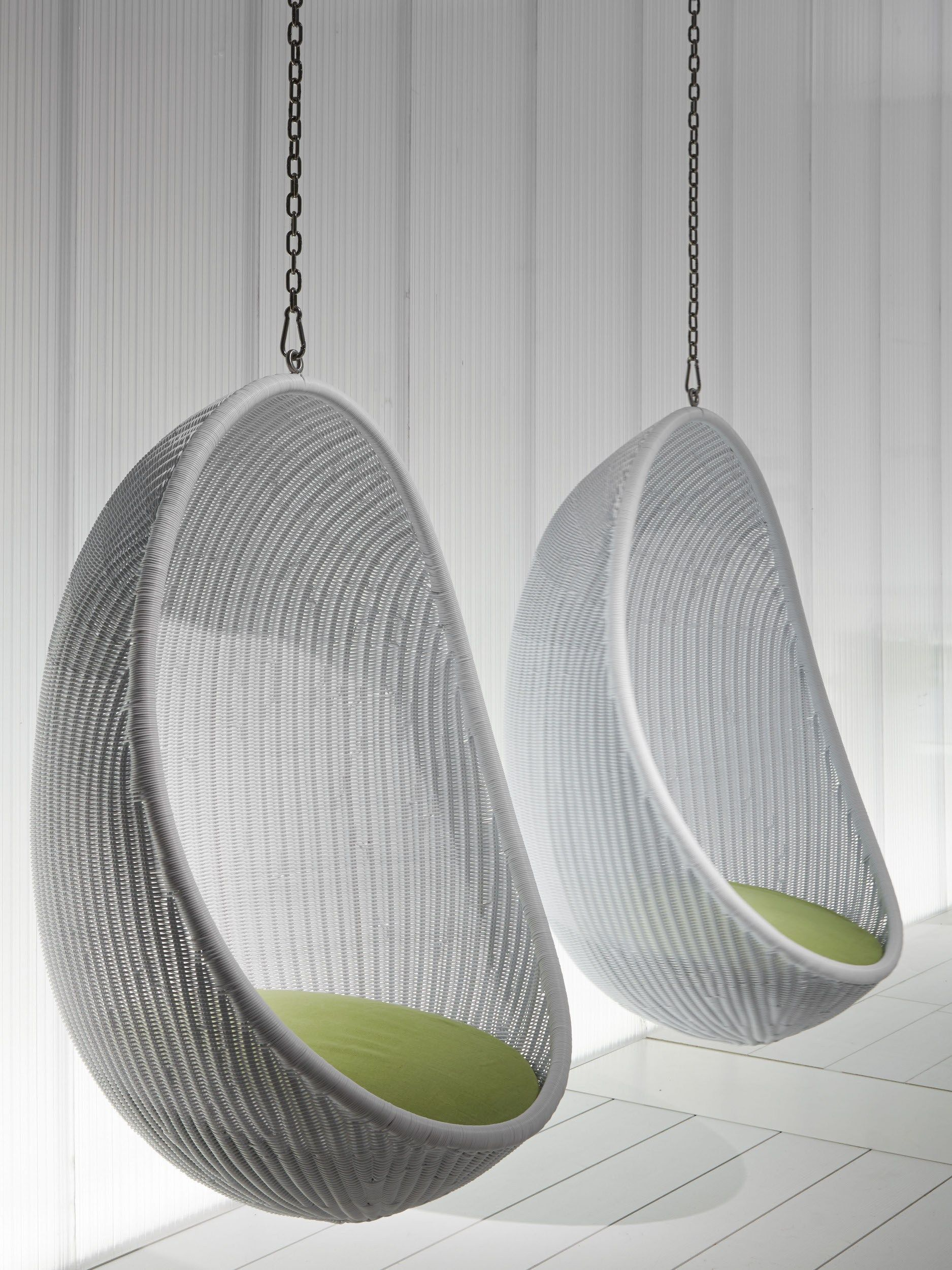 Furniture Nice Looking White Woven Rattan Two Hanging Egg Chair With White Wooden Wall Panels