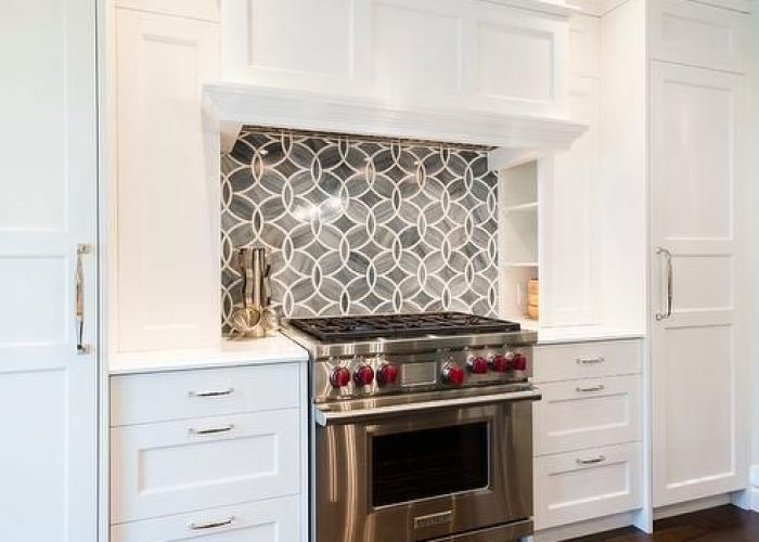 Back splash tile gorgeous kitchen boasts white shaker cabinets painted benjamin moore heron paired princess quartzite countertops and ann sacks also