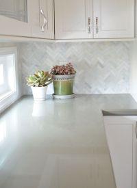 White cabinets with marble herringbone backsplash and sage ...
