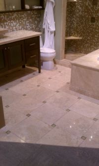 Travertine tile with green glass tile in pinwheel ...