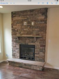 Stacked stone fireplace with TV mount