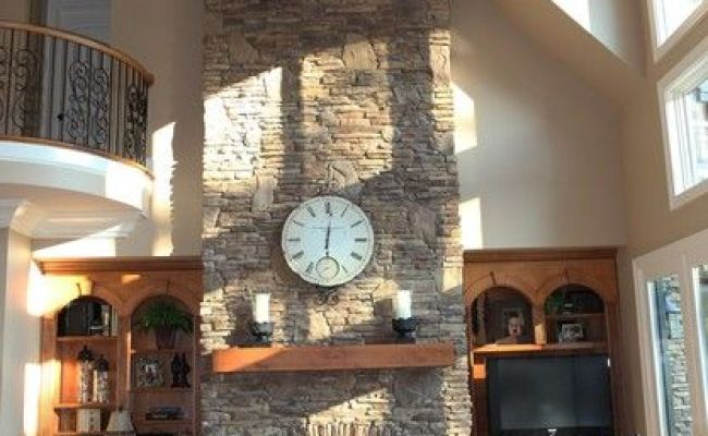 Beautiful Great Room With A Two Story Fireplace Rustic
