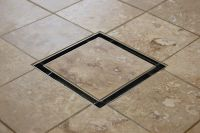 This attractive tile-in drain is an affordable alternative ...
