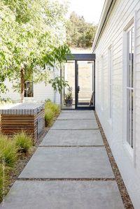 Walkway in outdoor courtyard of modern design home by ...