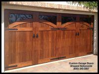 Mediterranean Garage Door Designs in solid wood. This door