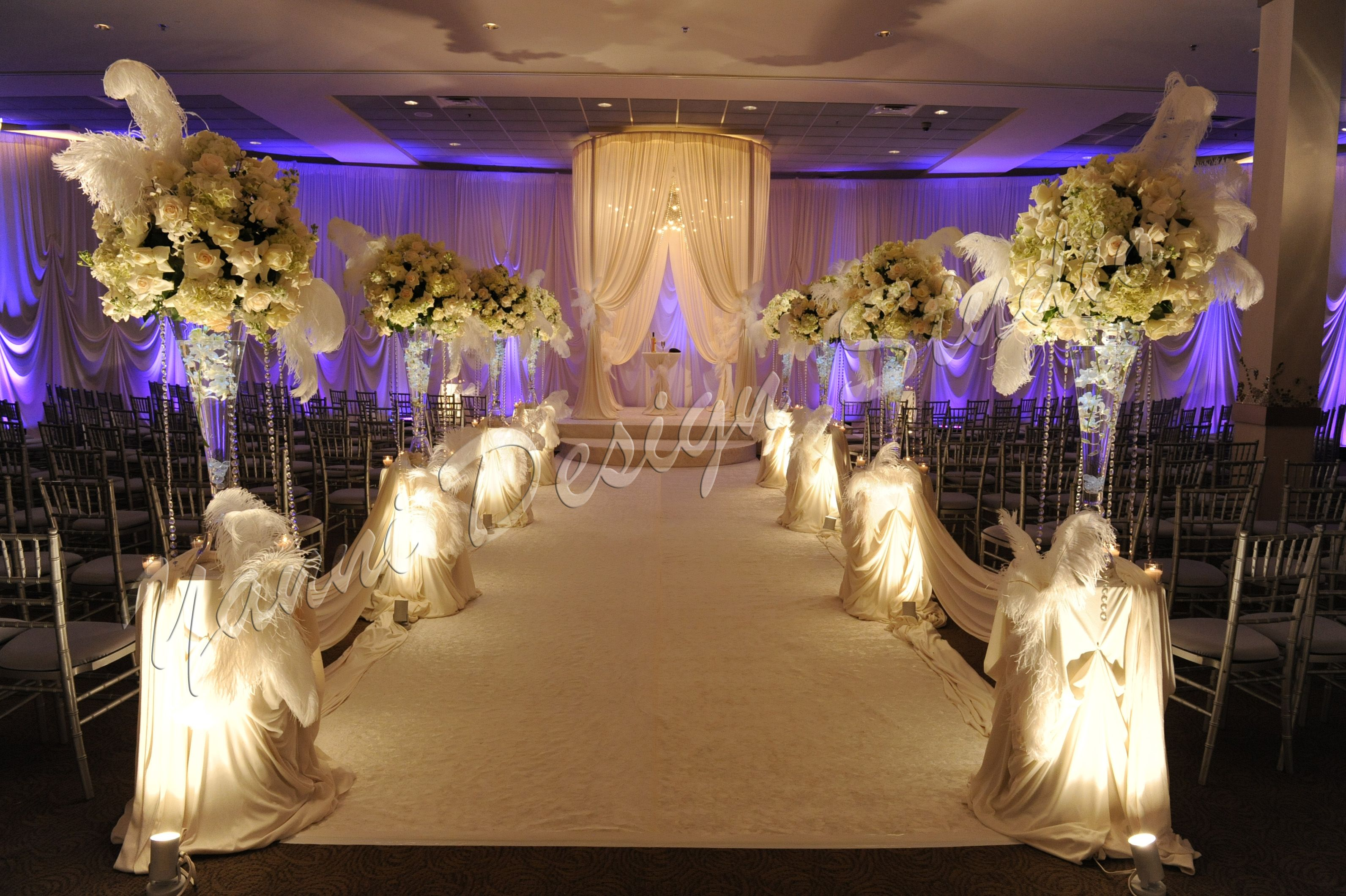 White Floral Arrangements Decorated With Feather Accents