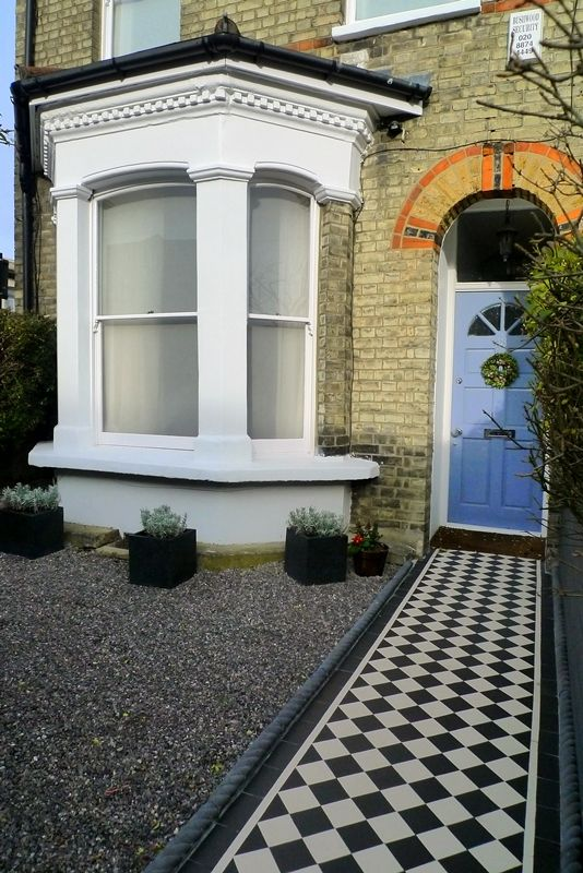 Formal Front Garden With Black And White Victorian Style Path And