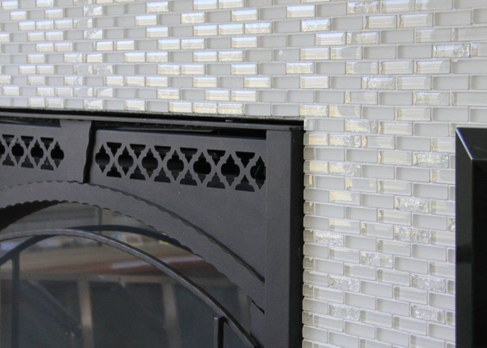 Home improvement laying tile on  fireplace walls or backsplash also we recently moved into new and have been busy re vamping