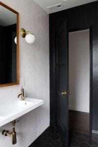 bathroom renovation // herringbone tile // brass fixtures ...